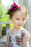 Little girl in colorful dress and flowers. Royalty Free Stock Photo
