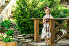 Little girl in colorful dress and flowers. Stock Images