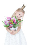 Little girl with colorful flowers over white Royalty Free Stock Photography