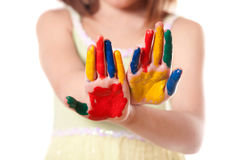 Little girl with colorful hand Stock Image