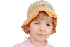 Little girl with colorful hat Stock Image