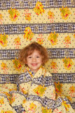 Little girl in colorful linen Stock Photos