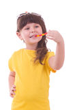 Little girl with a colorful lollipop Royalty Free Stock Photography