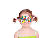 Little girl with colorful party mask Stock Photography