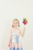 Little girl with colorful pinwheel. Stock Images
