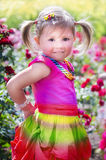 Little girl with a colorful rainbow dress Royalty Free Stock Photo