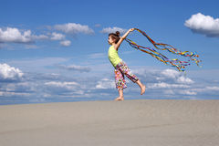 Little girl with colorful ribbons on beach Royalty Free Stock Photos