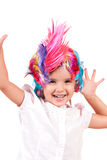 Little girl with colorful wigs Royalty Free Stock Photo