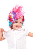 Little girl with colorful wigs Royalty Free Stock Images