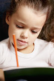 Little girl coloring Royalty Free Stock Images