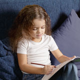 Little girl coloring book Royalty Free Stock Photography