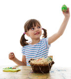 Little girl coloring easter eggs Royalty Free Stock Images