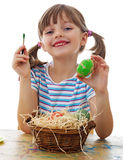 little girl coloring easter eggs Stock Image