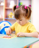Little girl coloring a picture in preschool. Cute little girl coloring a picture in preschool Royalty Free Stock Photo