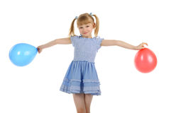 Little girl with colour balls Stock Image