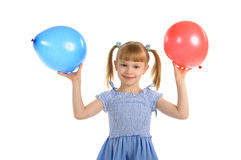 Little girl with colour balls Royalty Free Stock Images