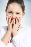 Little girl with colourful nails. Closeup Stock Images