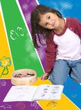 Little girl colouring Stock Photography