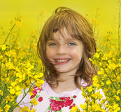 Little girl with colza flower Stock Photo