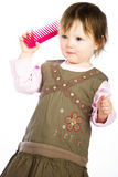 Little girl with comb Stock Photos