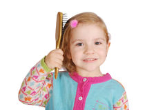 Little girl comb her hair Royalty Free Stock Photos