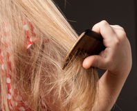 Little girl combing her beautiful long hair Royalty Free Stock Images