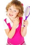 Little girl combing her hair Stock Photo