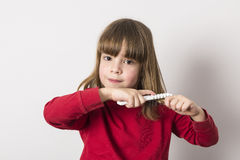 Little girl combing royalty free stock photography