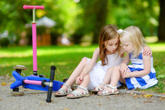 Little Girl Comforting Her Sister After Accident Royalty Free Stock Images
