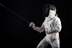 Little girl in complete fencing costume and epee Royalty Free Stock Images
