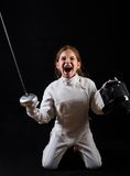 Little girl in complete fencing costume and epee Stock Image