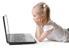 Little girl with a computer Royalty Free Stock Photo
