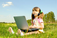 Little girl with computer Stock Photography