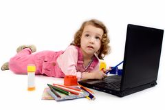 A little girl with computer Royalty Free Stock Photography