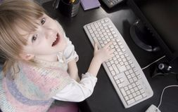 Little girl and computer Stock Photo