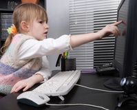 Little girl and computer Royalty Free Stock Photos