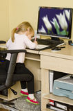 Little girl at computer desk Royalty Free Stock Photography