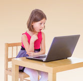 Little girl at the computer. Stock Image