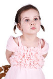 Little girl conceal her toy. Little girl in pink dress conceal her toy. White background royalty free stock photo