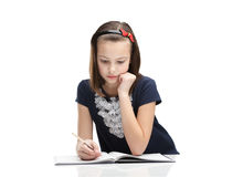 Little girl concentrates on the task Stock Photos