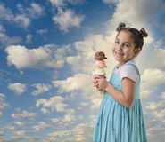 Little girl a cone with three ice cream flavors Royalty Free Stock Photos