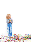 Little girl and confetti Stock Images