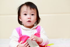 Little girl confused look Stock Photo
