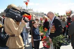 Little girl congratulates the Veteran of War royalty free stock photography