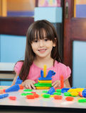 Little Girl With Construction Blocks In Classroom Royalty Free Stock Photography