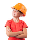 Little girl in the construction helmet. Looking up Royalty Free Stock Photo
