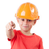 Little girl in the construction helmet. Points hand forward Royalty Free Stock Image