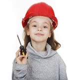 Girl in the construction helmet with a screwdriver. Stock Photos