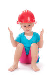 Little girl in the construction red helmet on head Royalty Free Stock Photography