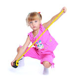 Little girl with construction tools. Royalty Free Stock Photo